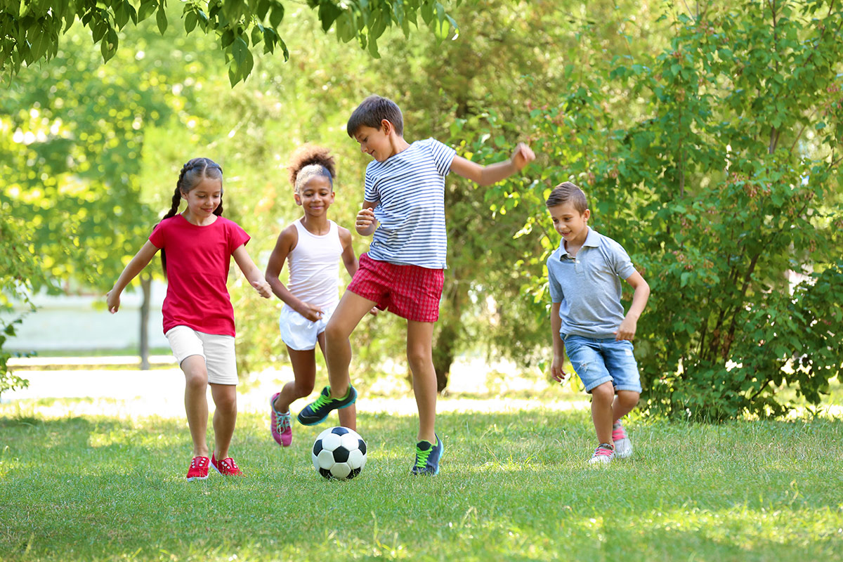 four children playing soccer
